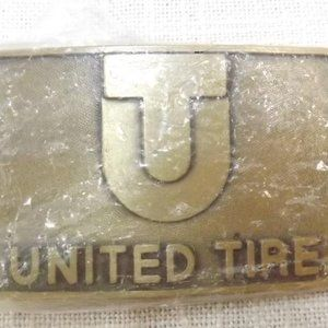 Vintage United Tire Heavy Equipment Belt Buckle